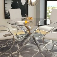 Anchor your dining space in ultracontemporary style with this round dining table. Crafted of metal in a gleaming chrome finish, this table features a modern, sculptural pedestal base composed of four angular, slanted posts. Small leveler feet ensure a balanced, even table, while round supports affix the base to the 0.25