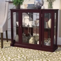 Beautifully display your curated collections with pride in this lighted curio cabinet. Measuring 33