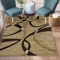 Add a touch of contemporary appeal to your floors with this lovely rug. A stylish foundation perfect for any room, it showcases an abstract pattern with overlapping arches. The neutral chocolate, beige, cream, and black color palette gives this rug versatility, so you can add it to any ensemble. It is woven in Turkey from 100% olefin, so it is stain- and fade-resistant, and it can hold up to high-traffic.
