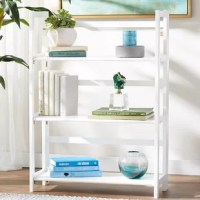 Customize your storage space with this cleverly-designed Reanna 3 Shelf Folding Standard Bookcase. Made from solid rubberwood, this innovative shelf system strikes a tall rectangular silhouette with an openwork frame. Great for small spaces, this piece displays your favorite knickknacks and curios with ease, then folds up flat for effortless storage when it's not in use. Perfect for displaying framed photos of fondly-remembered vacations and unforgettable wedding receptions, rows of your...