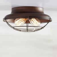 A new twist on bold industrial style, this handsome flush mount illuminates your space with factory chic appeal. Constructed out of metal, this charming design showcases a wide-brimmed inverted dome mount, while a wire cage shade ensconces a crisscross product for a stylishly slanted look. Perfect paired with Edison bulbs for an added dose of vintage character, this piece looks right at home shining ambient light on a breakfast nook in your open concept, eat in kitchen, or brightening your...