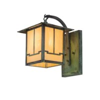 An abstract valley design comes to light with this striking solid brass wall fixture, which features a beige Iridescent art glass diffuser. The luminaire is complemented with hardware and accents featured in a verdigris finish. This Craftsman Signature fixture is listed for indoor and outdoor lighting applications, dimmable energy efficient lamping options.