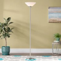 Illuminate your home in classic style with this sophisticated floor lamp, the perfect luminary for any corner of your home. The flared frosted shade imbues this lovely design with a touch of unexpected elegance, while the brushed steel or silver zinc stand and slim silhouette gives it a pop of sleek style. Set it in an unused corner of your living room, then pair it with two worn Chesterfield armchairs and a red Persian rug to craft an inviting and illuminated reading nook. Or place this lamp...