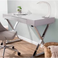Whether you are working on your laptop or writing thank you notes to family and friends you'll love the ample workspace of this desk. The contemporary frame with a glossy finish and shiny metallic x-shaped legs effortlessly elevate this look with striking appeal and will bring a touch of modern to your home or office. With one drawer at the center, you can store pens and papers at an arm's reach. This piece is crafted from manufactured wood and metal.