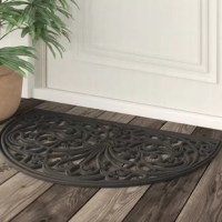 Eco-friendly meets elegance in this distinctive doormat. Machine-made in India from 100% recycled rubber, it offers a durable and easy-to-clean design that can be used both indoors and out. Its semi-circle silhouette measures 18'' W x 30'' L, perfect for the entryway or front porch. Though its openwork scrolling pattern is sure to draw the eye, it showcases a neutral solid hue that's versatile enough to work well in any setting.