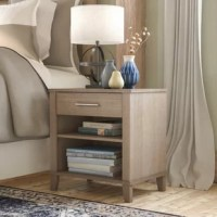 Whether beside your bed or acting as an end table in the living room, this nightstand makes a lovely stage and storage piece. Founded atop four tapered feet, its frame is crafted from manufactured wood and features a neutral gray finish that works in any aesthetic. Searching for somewhere to set your books or stationery? Simply take to the two open shelves and single bar-pull adorned drawer to tidy up in style.