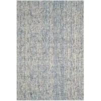 Set an artful foundation in your living room seating ensemble or breezy master suite with this eye-catching area rug. Made in India, it is tufted from 100% wool pile with a low profile for easy cleaning (we recommend taking it to a professional). Its patterned design makes a statement in your space, showcasing cool hues of dark blue and rust. To keep this piece safely in place, we recommend using a rug pad.