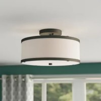 A little illumination goes a long way. Just take this flush mount for example: Though suspended just a few inches from the ceiling, it still brings a bit of style and shines to your entryway or kitchen ensemble. It is metal frame gives this fixture a pop of polish, while three lights inside are highlighted by a white drum shade for an even gleam. Assembly and installation are required for this hardwired luminary.
