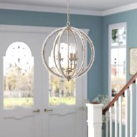 Be it an entryway in need of a little illumination or a kitchen island searching for some shine, this pendant is the perfect pick. Crafted from metal, its frame features an openwork globe silhouette finished in a metallic tone for a hint of glamour. Three candelabra-inspired lights sit in the center to cast a warm glow, but clear crystal accents make it shine.