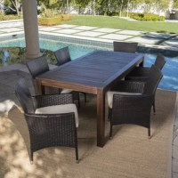 This clean and simple Appel Outdoor 7 Piece Dining Set With Cushion combines the functionality of wood and iron with the comfort of wicker. Complete with a table and 6 wicker dining chairs, this set offers comfortable seating in the great outdoors. Sure to complement any patio décor, this dining set offers you a stylish wooden design with the functionality of an iron framework and comfortable wicker chairs, guaranteed to give you a weather resistant set that will last yours for years to come.
