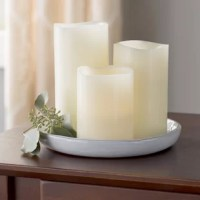 Candles instantly up the ambiance of any ensemble, but if that flickering flame has you fearing a fire hazard we have the perfect solution - this pleasant three-piece faux candle set! Featuring a traditional pillar design in a versatile beige hue, each stands at a separate height and is crafted of beeswax for a realistic look. Inside, you'll find a flame-less light controlled by a remote so you can get the glow without even having to get out of bed. Cluster them atop your nightstand for a...