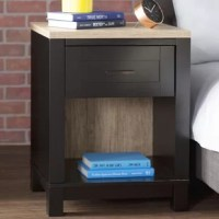 Finding a nightstand you love is essential. They're the last thing you see before you fall asleep; they're the first thing you see when you wake up. And, while the stacks of books you keep there change over time, as do the reading lamps, the foundation stays the same. This contemporary one for example, is crafted from solid and manufactured wood, and features a drawer to store small items out of the way, and one shelf to display books or decorative items.