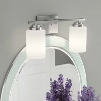 Illuminate your bathroom is a clean, transitional style with this two-light vanity light! Crafted of steel in a handsome metallic finish, this fixture features a clean-lined rectangular backplate complete with two short, straight arms. Suspended from a horizontal rod, a pair of frosted white glass cylindrical shades ensconce 100 W incandescent E26 medium base bulbs (not included) to diffuse ambient light as it's dispersed throughout your space. UL-listed for damp indoor locales.