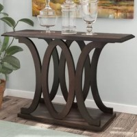 Just as much of an art piece as it is a display stage, this console table is sure to be the star of your entryway ensemble or living room look. Measuring 30'' H x 42'' W x 15.5'' D, its frame is constructed from manufactured wood and features an openwork design throughout the center with a dark cappuccino finish. Assembly for this product is required, and instructions are easily accessible with a PDF available on our site.
