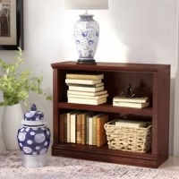 Introduce understated design and essential storage to your space with this bookcase, an essential for decluttering and organizing. Crafted from manufactured wood, it features a streamlined silhouette and carved details that give it a traditional look. Two open shelves provide ample space to display books, craft decorative displays, and keep other decorative accents close at hand. It's sized to fit into your room, office, or living room without taking up too much real estate.