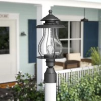 Make a great first impression on guests, and craft a welcoming and inviting atmosphere with this charming post lantern. Blending classic style with a touch of nautical charm, it showcases a powder-coated steel frame with turned details and a tiered top. The urn-shaped shade is crafted from clear crackled glass and it surrounds the 60-watt bulb within (not included). This lantern is hard-wired and can be used in wet locations.