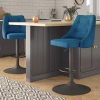Contemporary style abounds with this adjustable gas-lift bar stool, showcasing a swivel design. This bar stool's seat showcases a bucket design, outfitted with button tufted details and wrapped in a soft textured fabric, available in multiple color options. Support the seat is a metal pedestal base showcasing a solid gunmetal finish for a touch of industrial style. With its winged back and stitched pattern, this seat is sure to make a statement in any arrangement.