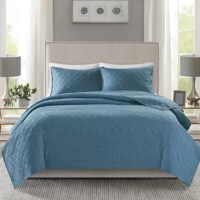 Simple and elegant, this 3 Piece Coverlet Set offers a luxuriously comfortable update to your bedroom. This quilted coverlet and matching shams feature two distinct quilting patterns that create an alluring textural look. A geometric design alternates with a circlet ogee pattern for added dimension and charm, while the pre-washed fabric and cotton-rich filling provide incredible softness and comfort. Machine washable for easy care, this quilted coverlet set transforms your bedroom into a cozy...