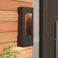 Your outdoor lighting is an important touch to rounding out your home: not only does it make your spaces safer by brightening them up, it also sets the tone for your home decor from your front door. A sconce like this, for example, is a great way to light up your space with a contemporary look. Crafted from metal with an open rectangular silhouette, this sleek piece includes a halogen bulb, saving you a trip to the hardware store. And since it's designed with wet spaces in mind, it's perfect...