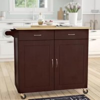 Ensure every pot and pan has a place in the heart of your home with this clean-lined kitchen island, an organizing solution that's set on casters for optional mobility. Crafted from solid and manufactured wood, this piece features two drawers and a two-door cabinet with ample room to store spare utensils, mixers, and more. Its natural-finished top provides extra counter space for chopping veggies and preparing meals, while a convenient towel holder on one side offers even more function.