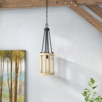A contemporary twist on traditional elements, wood lighting makes your space shine with rustic style. Take this mini pendant for example: pairing cast iron with an openwork wood shade finished in distressed oak, it's the definition of industrial. Inside, you'll find a single exposed bulb gleaming through. Measuring 28'' H x 8'' W x 8'' D, it's the perfect pick for brightening up the breakfast nook or lending illumination to the entryway.