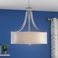 Brighten your space in curated contemporary style with this three-light drum chandelier! Crafted of metal in a fashionable finish, this fixture features a sleek drum-shaped pendant holder and four swooping arms. A frosted glass drum shade and a sheer fabric outer diffuser ensconce three 60 W E26 medium base bulbs (not included) to soften ambient light as it's dispersed throughout your space. Rounding out the design, an adjustable length of chain suspends the whole unit from a matching canopy...