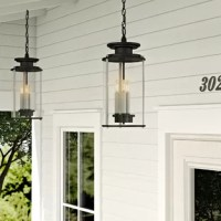 Greet guests with a warm and welcoming glow before you even reach the front door with this hanging lantern, perfect for the porch or patio. Designed to live outdoors, it is crafted from weather-resistant steel that doesn't mind some sunlight or a little rain rolling through. Its cylindrical silhouette, with three candelabra-inspired lights inside highlighted by a glass shade. Available in two finishes, so you can choose the one that best suits your alfresco space.