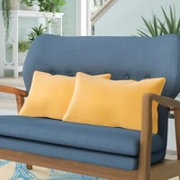 Relax outside without having to rough it with this outdoor lumbar pillow, a piece that provides plenty of back support. Proudly crafted in the USA, it features a sewn-on cover made from Sunbrella fabric for a weather-resistant design that won't mind sitting out in the sun or rain. Its solid hue helps it blend with your existing arrangement, while waterfall edges offer a tailored touch. For easy upkeep, just clean with mild soap and warm water as needed.