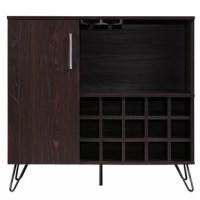 Keep your wine collection and stemware stored in style with this eye-catching bar cabinet. Whether hosting a fancy soiree with close friends and colleagues or enjoying a nightcap before lights out, this piece is the perfect pick for keeping your wine and spirits corralled while lending a touch of modern style. Founded atop iron legs, it features a manufactured wood frame awash in a solid neutral finish for a versatile look that complements nearly any color palette.