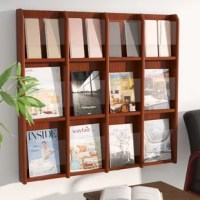 Ideal for both waiting rooms and personal reading nooks alike, this wall display lets you pile in periodicals and keep magazines stowed in modern style. Pairing a wood frame with plastic pocket protectors, it showcases a neutral solid finish and measures 36.75'' H x 40'' W x 3'' D. Just mount it onto the wall of your choice, then fill its 12 pockets with your favorite printed materials for easy and eye-catching access.