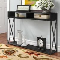 The entryway, an empty hall, or the living room – this console table can go anywhere, turning a spare space into a decorative display. Founded atop a metal base with x-shaped supports, it features a manufactured wood top that spans 47.25'' wide and showcases two divided compartments perfect for stashing objets d'art, family photos, and more, while an open shelf down below offers additional space to stage items of your choice.