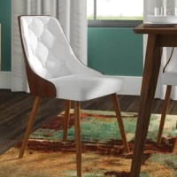 Looking to refresh your dining space? Swapping out your old seats for a chair like this is a great way to lend your home a fresh, sleek look. Crafted from a bentwood frame founded on four tapered dowel legs, this piece delivers an on-trend mid-century look at your dinner table. Faux leather upholstery on the seat and back lends this chair a touch of padding, while button tufting rounds it out with an on-trend look.