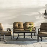 Create a compelling and cohesive aesthetic in your arrangement with this six-piece sofa set – which includes a loveseat, coffee table, end table, ottoman, and two spring chairs. Crafted from metal, each piece boasts a curving frame awash in an antique bronze finish, blending well with your color scheme. Scrolled detailing offers a touch of traditional appeal, while the included polyester cushions give it an inviting feel. Plus, the weather-resistant finish makes this set ideal for the...