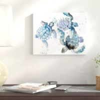 Lending additional layers of color and texture to any ensemble while ridding your home of boring, empty wall space, wall art is a must-have for any abode. Take this piece for example: the perfect pick for cozy coastal homes, nautical-themed ensembles, or seaside-inspired settings, it showcases a trio of turtles awash in hues of blue and white. Made in the USA, it's printed on gallery-grade canvas and professionally wrapped around a wood frame for a free-floating feel.  Bring some nautical...