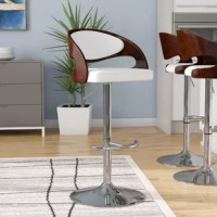 Bring mid-century modern styling to any pub table or kitchen island with this Lanesboro Adjustable Height Swivel Bar Stool. Made from bentwood ply in a rich walnut finish, this stool's backrest strikes a curved silhouette with an open lower back, while faux leather upholstery padded with foam fill lines the seat. Crafted of metal in a chrome finish, the stool's pedestal base features a circle-shaped footing, a built-in footrest, and a 360° swivel mechanism, while a lever-activated...