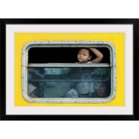 I Want To Go Back Home by Jay Satriani, print wall art. A young boy looking out a window of a yellow bus.