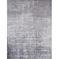Bring a touch of modern style to your living room look, bedroom base, and beyond with this stylishly understated area rug. Crafted in India, this handmade piece sports a cotton back and boasts a faded design for a look that fuses contemporary style with a dash of rustic charm. And with a neutral gray finish, it's designed to complement nearly any color palette. It features a 0.25