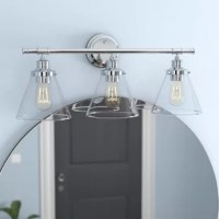 Combining a modern refined vintage silhouette with an industrial pipe look, this vanity light is crafted from stainless steel and elevates any space in an eye-catching style. Three glass shades diffuse light from any medium-base bulbs up to 60 W (not included), while a damp location rating makes it a smart selection for your washroom.