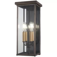 This Maultsby 4-Light Outdoor Wall Lantern is a straightforward exterior lighting fixture. It features a rectangular clear glass box framed in oil rubbed bronze finish with gold highlights.