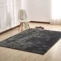 The Manya Hand-Tufted Gray Area Rug with a soft plush feeling to comfort your home decor idea. What you're buying is a resembles realistic sheepskin fur. A fake fur shag area rug that looks and feels real.