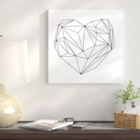 Give a little love to your bare walls with this piece of wall art. This simple print features a black line drawing of a heart with a diamond fractal-like pattern. This print is created on an artist-grade canvas that is professionally stretched and stapled over wood bars in gallery wrap style. Fade-resistant archival inks guarantee perfect color reproduction that remains true to color even when exposed to strong light. A simple print like this can be added to a gallery wall with similar pieces...