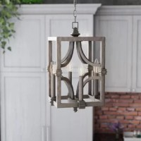 Whether it's for their eye-catching style, handy illumination, or space-conscious design, pendants lights are popular picks when it comes to lending your home a bright touch. This pendant, for example, is a great option for a vintage-inspired touch in any ensemble. Crafted from metal with an aged steel finish, this piece features curving arms in the center of the fixture, with four candle-style lights on the outside. This luminary accommodates four 60 W candelabra bulbs, although none are...