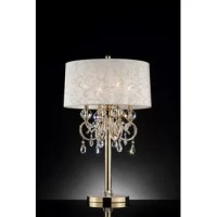 This beautifully crafted table lamp will brighten any room or living space while accentuating the interior design. Features a uniquely leaves-and-vines patterned, white-colored fabric lampshade lined with a satin finish. Adorned with hanging crystal droplets and arms lined with elegant beads. The base is metal with a polished gold finish accented with a crystal piece. Perfect for displaying in a living room, bedroom, or other living space.