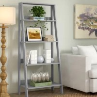 Whether you need a spot to stow your favorite reads in the den or you're organizing baskets filled with accessories in your master suite, this ladder bookcase is the perfect pick. Crafted from manufactured wood, its frame features a contemporary slanted silhouette and a neutral solid finish that works in any aesthetic or color palette. Its four shelves are ready for anything, whether it's displaying your favorite decor or storing extra memorabilia.