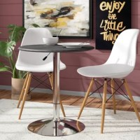 Whether you're looking to establish a breakfast nook in your kitchen or you're outfitting an at-home bar, this modern pub table is the perfect pick. Founded atop a steel pedestal base, this chrome-finished piece features a round wooden top with a black PVC vinyl covering that's easy to wipe clean with a damp cloth. Its compact footprint makes it an ideal option for smaller spaces (it measures just 26.5'' H x 25'' L x 25'' W!), while a hydraulic lift mechanism underneath its tabletop lets you...
