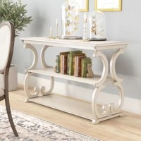 Add a dash of classic character to your entryway or living room with this traditional console table. Crafted from manufactured wood and solid veneers, it showcases an open design with scrolling accents on its sides for a decorative touch. As functional as it is charming, this piece features a rectangular top and two lower tiers that provide plenty of space to stage framed photos, potted plants, books, and more. Assembly is required.