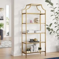A modern take on a traditional staple, this streamlined bookcase brings glam appeal to any space. Crafted of metal in a satin gold finish, this bookcase strikes an open etagere silhouette featuring a crown arched top and for straight legs. Rounding out the design, five safety-tempered glass shelves provide perfect platforms for everything from framed photos to rows of your favorite read.