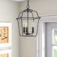 From providing the first impression in the entryway to illuminating stairwells and hallways, the foyer lantern brings style and function home. Pairing a classic lantern silhouette with an open steel frame, this lantern brings home traditional style with a feel of minimalism. Three candle bulb sockets accentuate this lantern time-honored influence, while a royal ebony finish washes over the entire fixture. Even better, this design is compatible with vaulted ceilings and has an adjustable height....