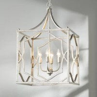 An artful blend of old-world style and modern appeal, this lantern is a style chameleon! Crafted from steel in a crackled and patinaed metallic finish for an antique look, this chain-hung light strikes an open cube silhouette with updated quatrefoil side panels, an elegant canopy topper, and a dimmable candle-style fixture. Perfect for making a grand statement in your curated foyer, this piece is also right at home casting light on your glam contemporary dining ensemble.