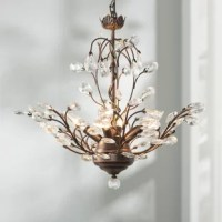 Greet guests with a warm and welcoming glow in the entryway or dress up your dining room for an upcoming dinner party with this eye-catching chandelier. Crafted from metal finished in brownish-black, its frame features twisting twig-like arms and crystal leaf accents for a glint of glamour. Four lights are what make it shine, hidden among its intricate frame. This fixture measures 18.6'' H x 20.5'' W x 20.5'' D.